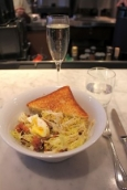 3. Frisee salad aux lardons and a glass of prosecco at Cafe Bouchon